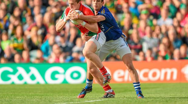 Key moment... Kerry's Shane Enright was lucky to avoid a black card (which would have seen him get a red card) for this foul on Mayo's Cillian O'Connor for a first-half penalty in Limerick on Saturday. Photo: Stephen McCarthy / SPORTSFILE