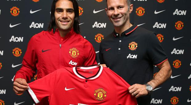 New Manchester United striker Radamel Falcao with assistant manager Ryan Giggs