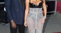 Kim Kardashian West and Kanye West arrive at the GQ Men of the Year Awards at the Royal Opera House, London. PRESS ASSOCIATION Photo. Picture date: Tuesday September 2, 2014. Photo credit should read: Daniel Leal-Olivas/PA Wire