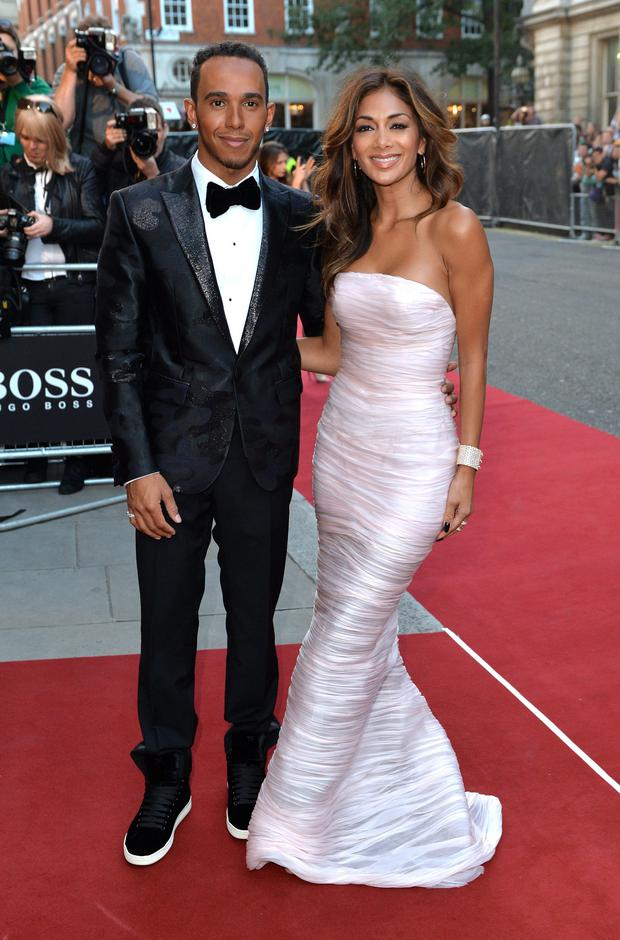 Lewis Hamilton and Nicole Scherzinger attend the GQ Men of the Year awards at The Royal Opera House on September 2, 2014 in London, England. (Photo by Anthony Harvey/Getty Images)