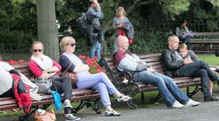 People enjoying good weather in St. Stephens Green, Dublin