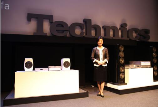 Picturrd: Michiko Ogawa, Technics director, with new Technics stereos