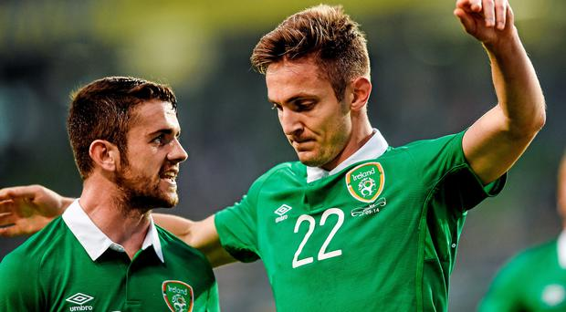 Kevin Doyle, Republic of Ireland, right, celebrates with teammate Robbie Brady after scoring the opener