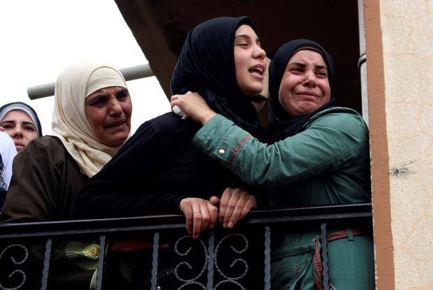 The wife of Lebanese soldier Ali al-Sayyed, who was beheaded by Islamic State militants in Arsal, mourns during his funeral in his hometown of Fnideq in Akkar. Islamic State militants beheaded al-Sayyed, a Lebanese soldier who was one of 19 captured by hardline Syrian Islamists when they seized the Lebanese border town for a few days last month