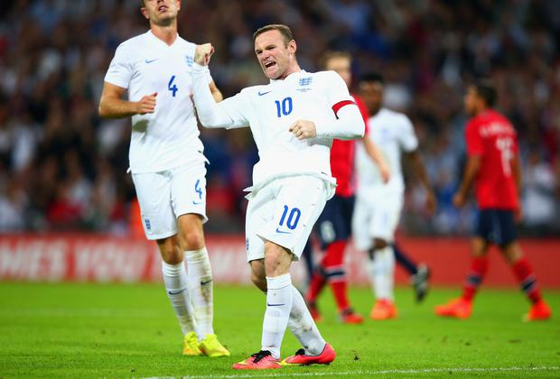 Wayne Rooney celebrates after scoring a from the penalty spot against Norway