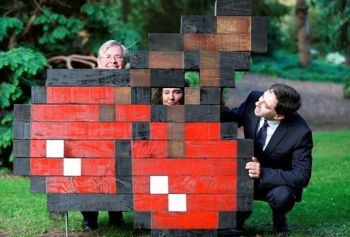 Simon Harris with Matthew Jebb (Director of the Botanic Gardens) and Jackie Ball Secetary of Sculpture in Context in the National Botanic Gardens beside artists Deidre Hayden and Jeremy Simmons piece Cherry Wood at the unveiling of Ireland's largest outdoor sculpture exhibition