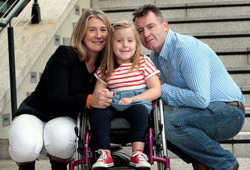Rory and Mary Fitzsimons from Naas,Co.Kildare with their 7 year daughter Emiy