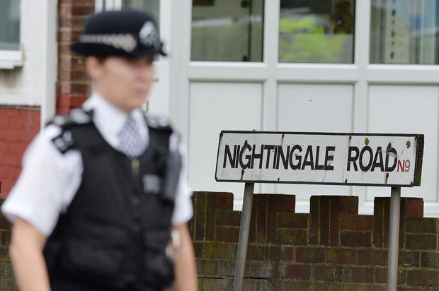 Police on Nightingale Road, Edmonton, north London where a woman has been beheaded in a back garden just after 1pm today