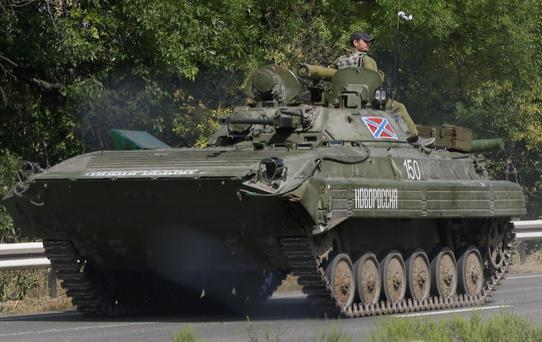 Pro-Russian rebels ride on an APC near the village of Berezove, eastern Ukraine