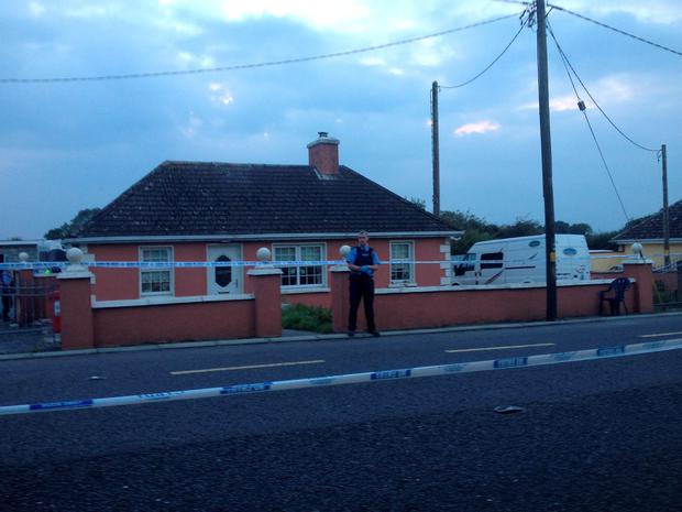 The scene at the house in Charleville this evening
