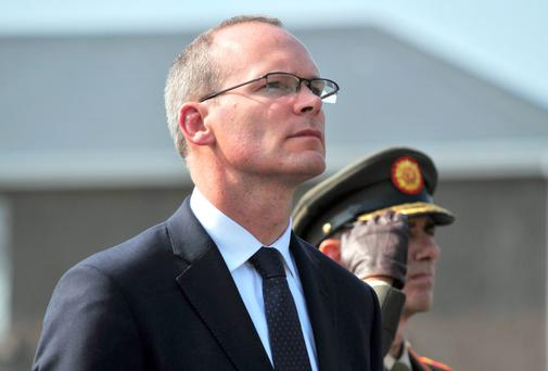 Minister for Defence Simon Coveney T.D. accompanied by the Chief of Staff of the Defence Forces Lieutenant General Conor O'Boyle at the Commissioning Ceremony of ten new Officers at the Naval Base, Haulbowline, Cork. Pic Daragh Mc Sweeney/Provision