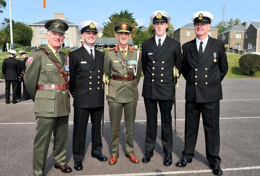 At the Irish Naval Service Officer Commissioning Ceremony in Haulbowline, Cork, were, from left,Cork Battalion Quarter Master John Nolan with his son James Nolan; Chief of Staff of the Defence Forces Lieutenant General Conor O'Boyle; newly commissioned officer Philip Molloy from Cobh with his father CPO Thomas Molloy