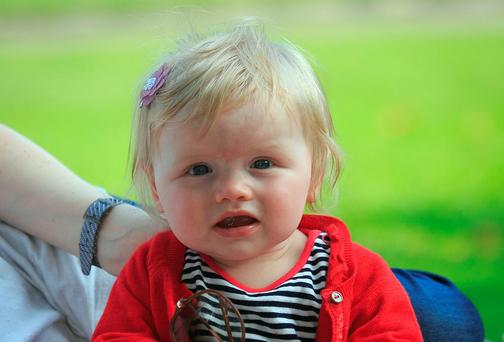 Fiadh O Riordan (9 months) from the City Centre enjoys the good weather in Merrion Square, Dublin yesterday. Photo: Gareth Chaney Collins