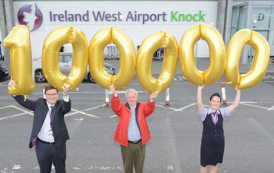 Pictured celebrating the 100,000th passenger through Ireland West Airport Knock this August are Joe Gilmore, Managing Director,Philip McGlynn, Bundoran, Co. Donegal (100,000th passenger) and Sarah Rowley, Head of Airline and Customer Airline Services.