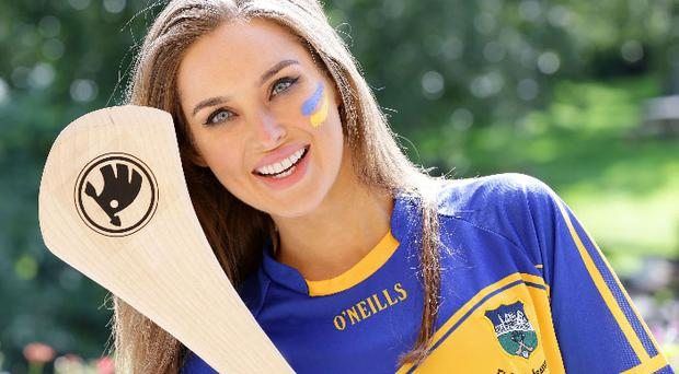 Roz Purcell and ŠKODA will be cheering for Tipperary in Croke Park this Sunday. ŠKODA has added the logo of their charity partner; Dogs Trust to this year's All-Ireland hurling final jersey.
