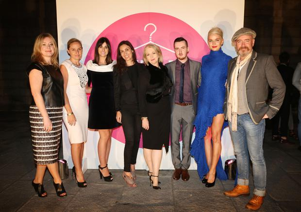 Pictured are the judging panel , Deirdre Devaney, Debbie O'Donnell, Stacey O'Donnell, Aisling Kilduff,Bairbre Power,winner Ciaran Gormley, model Teo Sutra, Barry McCall at the Dublin Fashion Festival Young Designer of the Year fashion show at Bank of Ireland, College Green, Dublin 2. Photography: Emily Quinn