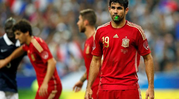 A fan uses a laser pointer on Spain's Diego Costa during their international friendly soccer match against France at the Stade de France