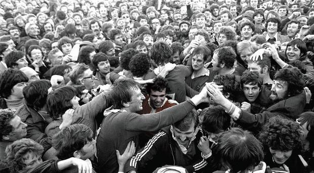 The Munster players, including Tony Ward (centre, with Moss Keane) are mobbed at Thomond Park on October 31, 1978 after the 12-0 victory over the All Blacks. Ward scored two drop goals and converted a penalty.