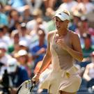 Caroline Wozniacki of Denmark reacts against Shuai Peng of China during their women's singles semifinal match on Day 12 of the 2014 US Open