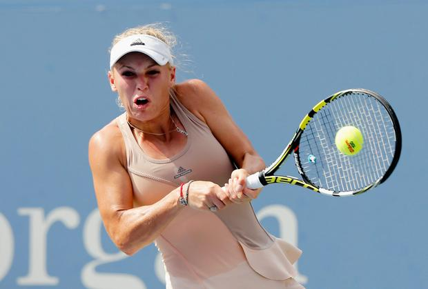 Caroline Wozniacki is through to the US Open final after her semi-final opponent Peng Shuai retired injured. Mike Stobe/Getty Images for USTA