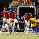 Brazil striker Neymar Junior (10) scores the game winning goal against Colombia