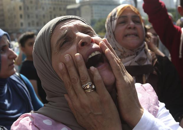 The mother of a missing Lebanese soldier who was kidnapped by Islamic State militants, shouts slogans against the Lebanese cabinet during a demonstration to demand action to secure the captives' release, in front the Lebanese government building, in downtown Beirut, Lebanon. (AP Photo/Hussein Malla, File)