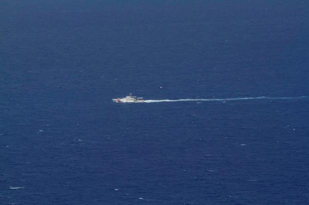 A U.S. Coast Guard boat participates in the search for the small plane belonging to real estate executive Larry Glazer a day after it crashed into the Caribbean Sea north of Port Antonio, September 6, 2014. The plane piloted by Glazer, who was accompanied by his wife Jane Glazer, flew off course on September 5 as it headed from Rochester, New York, to Naples, Florida, and crashed into the Caribbean Sea just northeast of the island, Jamaican authorities said (REUTERS/Jamaica Defense Force)