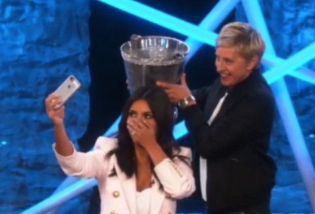 Ellen Degeneres gets ready to plunge the icy water over Kim.