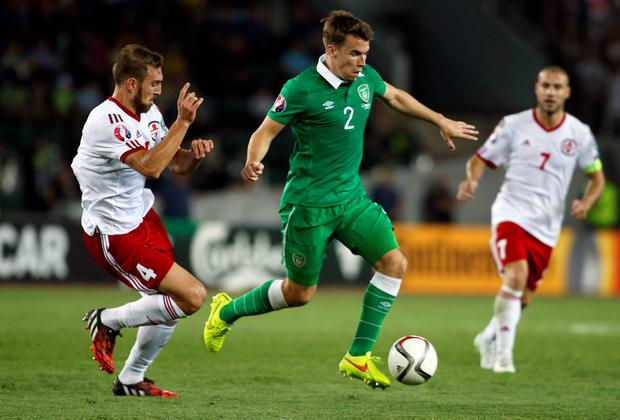 Georgia's Guram Kashia fights for the ball against Ireland's Seamus Coleman during their Euro 2016 Group D qualifying soccer match in Tbilisi. Photo credit: REUTERS/David Mdzinarishvili