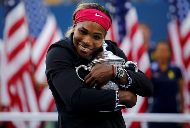 Serena Williams embraces her US Open trophy after defeating Caroline Wozniacki in the women's singles final in New York. Photo: REUTERS/Eduardo Munoz