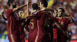 Spain's Sergio Busquets (second right) celebrates with teammates after scoring against Macedonia. Reuters/Heino Kalis
