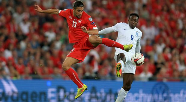 Switzerland's Ricardo Rodriguez (left) and England's Danny Welbeck battle for the ball during a UEFA Euro 2016 qualifier