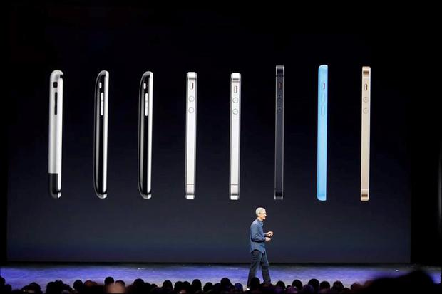 Apple CEO Tim Cook speaks in front of a row of iPhones during an Apple event at the Flint Center in Cupertino