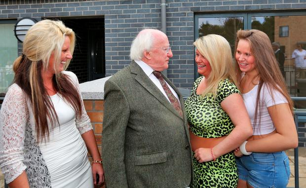 President Michael D Higgins with residents, from left, Lisa, Ellen and Winnie Collins