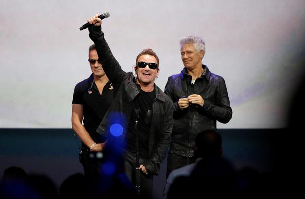 Bono gestures to the audience after performing at an Apple event at the Flint Center in Cupertino, California,