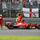 Ferrari Formula One driver Fernando Alonso (3rd L) of Spain looks at his car which stopped during the Italian F1 Grand Prix in Monza September 7, 2014. REUTERS/Stefano Rellandini (ITALY - Tags: SPORT MOTORSPORT F1)