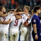 Players of the Czech Republic celebrate next to Daryl Janmaat of the Netherlands (R) after their Euro 2016 qualifying soccer match in Prague