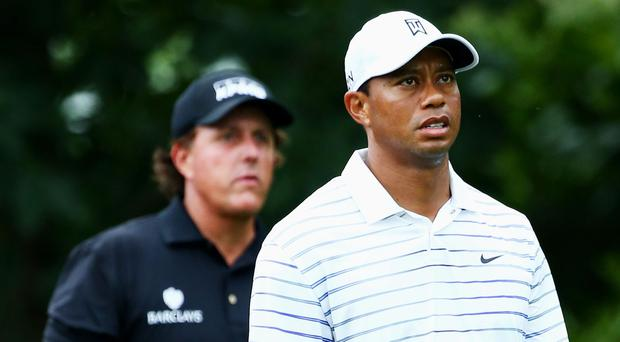 Tiger Woods and Phil Mickelson. Photo: Getty
