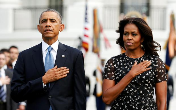U.S. President Barack Obama and U.S. first lady Michelle Obama observe a moment of silence on the 13th anniversary of the 9/11 attacks