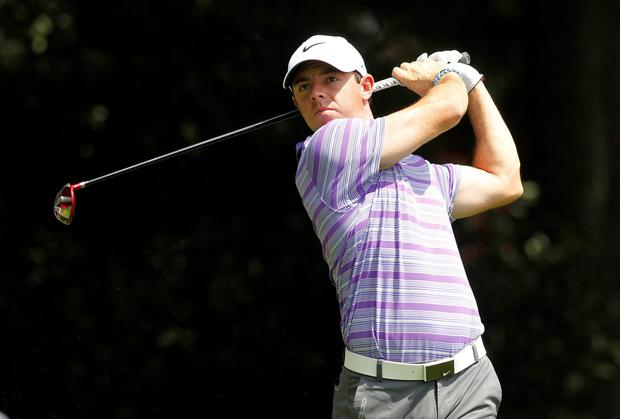 Rory McIlroy tees off on the third hole during the first round of the Tour Championship at East Lake Golf Club