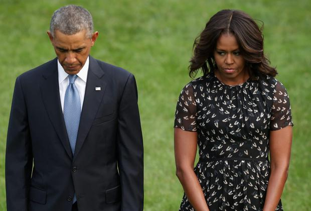 President Obama and his wife Michelle observe a minute's silence on the south lawn of the White House yesterday for the victims of 9/11. Photo credit: Chip Somodevilla/Getty Images