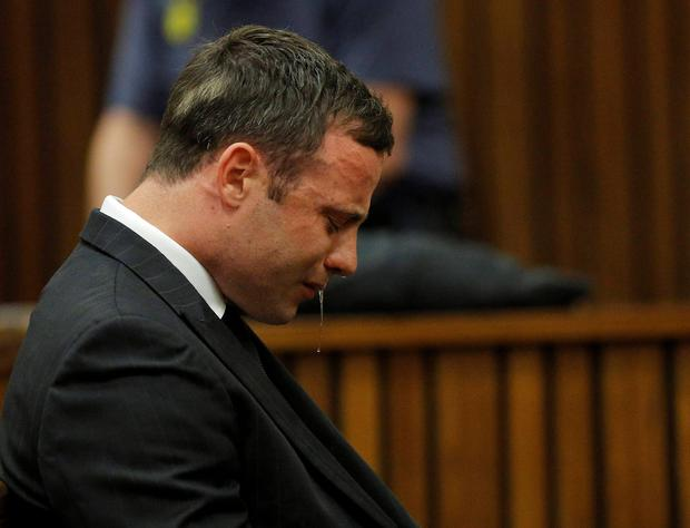 Olympic and Paralympic track star Oscar Pistorius reacts as he listens to Judge Thokozile Masipa's judgement at the North Gauteng High Court in Pretoria. A South African judge cleared Oscar Pistorius of all murder charges on Thursday, saying prosecutors had failed to prove the Olympic and Paralympic track star intended to kill his girlfriend or an imagined intruder on Valentine's Day last year. Photo credit: REUTERS/Kim Ludbrook/Pool