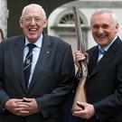 Ian Paisley and Taoiseach Bertie Ahern. Mr Ahern holds a three hundred year-old musket during their visit to the historic Battle of the Boyne site in Co Meath