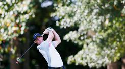 Rory McIlroy hits his tee shot on the eighth hole at the East Lake Golf Club