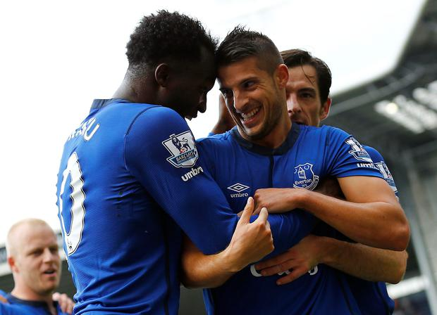 Everton's Kevin Mirallas (2nd R) celebrates his goal against West Bromwich Albion with Romelu Lukaku and Leighton Baines (R)