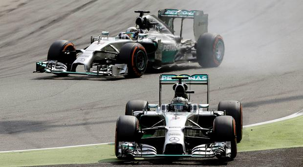 Mercedes Formula One driver Lewis Hamilton (top) of Britain passes his teammate driver Nico Rosberg of Germany during the Italian F1 Grand Prix in Monza September 7, 2014. REUTERS/Max Rossi