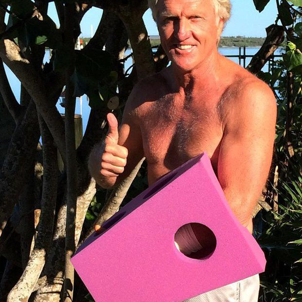 This photo provided by Greg Norman and posted on Instagram on Sunday, Sept. 14, 2014, shows Norman giving the thumbs up with his left hand protected by a purple foam after a chainsaw accident