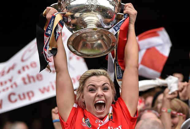 Rebelettes captain Anna Geary lifts the O'Duffy cup. Picture credit: Paul Mohan / SPORTSFILE