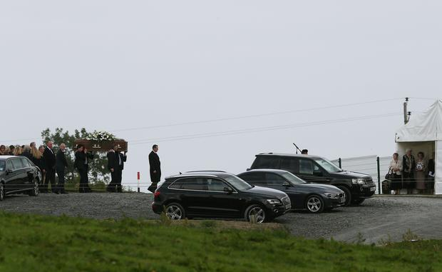 The coffin of former Democratic Unionist Party (DUP) leader and First Minister Rev Ian Paisley is carried to his grave at the Free Presbyterian Church in Ballygowan, Northern Ireland. Brian Lawless/PA Wire