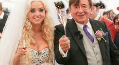 Playboy model Cathy Schmitz with her 81-year-old new husband, billionaire Richard Lugner, after their wedding at Schoenbrunn Palace in Vienna. Photo: Monika Fellner/Getty Images